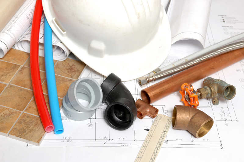 A spread of plumbing tools